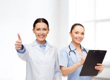 Smiling female doctor and nurse Royalty Free Stock Photo