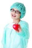 Smiling female doctor or nurse holding heart Stock Photo