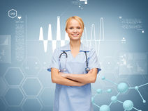 Smiling female doctor or nurse with stethoscope Royalty Free Stock Images