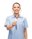 Smiling female doctor or nurse with stethoscope Stock Photography