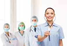 Smiling female doctor or nurse with stethoscope Stock Photos