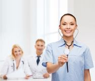 Smiling female doctor or nurse with stethoscope Royalty Free Stock Image