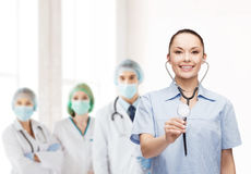 Smiling female doctor or nurse with stethoscope Royalty Free Stock Photography