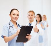 Smiling female doctor or nurse with stethoscope Stock Photo
