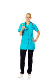 Smiling female doctor or nurse with stethoscope showing thumb up Royalty Free Stock Photos