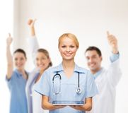 Smiling female doctor or nurse with tablet pc. Healthcare, medicine and technology concept - smiling female doctor or nurse with tablet pc computer Stock Images