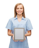 Smiling female doctor or nurse with tablet pc Royalty Free Stock Photo