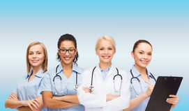 Smiling female doctor and nurses with stethoscope Royalty Free Stock Images