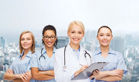 Smiling female doctor and nurses with stethoscope Royalty Free Stock Photo
