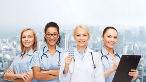 Smiling female doctor and nurses with stethoscope Stock Photography