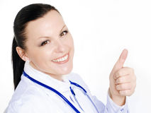 Smiling female doctor show thumb up sign Royalty Free Stock Photos