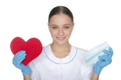 Smiling female doctor shows heart symbol. And the mask stock images