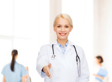 Smiling female doctor with stethoscope Royalty Free Stock Photography