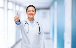 Smiling female doctor with stethoscope Royalty Free Stock Images