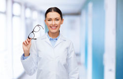 Smiling female doctor without stethoscope Stock Photos