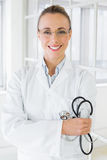Smiling female doctor with stethoscope in hospital Stock Images