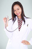 Smiling female doctor with a stethoscope Royalty Free Stock Image
