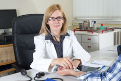 Smiling Female Doctor With Stethoscope Looking at Camera Royalty Free Stock Images