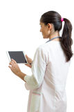 Smiling female doctor with stethoscope and tablet pc computer. Healthcare, medicine and technology concept. Smiling woman doctor with stethoscope and tablet pc Stock Images