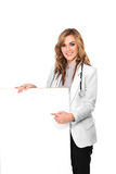 Smiling female doctor with stethoscope and white blank board, is Royalty Free Stock Images