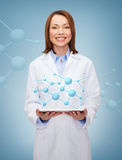 Smiling female doctor and tablet pc computer Stock Photos
