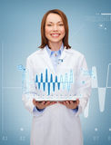 Smiling female doctor and tablet pc computer Stock Photo