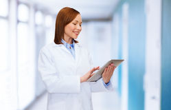 Smiling female doctor and tablet pc computer Stock Photography
