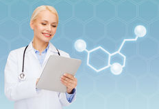 Smiling female doctor with tablet pc and molecule. Healthcare, medicine and technology concept - smiling female doctor with tablet pc computer and molecule of Royalty Free Stock Photography