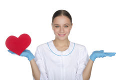 Smiling female doctor weighs on hand heart symbol Stock Photography