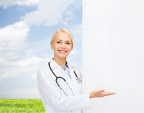 Smiling Female Doctor With Stethoscope Stock Photo