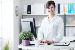 Smiling female doctor working at the clinic royalty free stock photo
