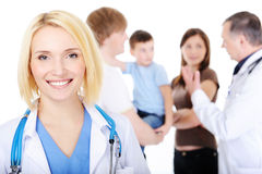Smiling female doctor with the young family Royalty Free Stock Photo