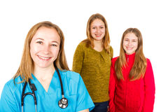 Smiling female doctor and young sisters Stock Images