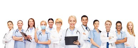 Smiling female doctors and nurses with stethoscope. Healthcare and medicine concept - smiling female doctors and nurses with stethoscope Stock Photo