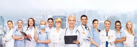 Smiling female doctors and nurses with stethoscope. Healthcare and medicine concept - smiling female doctors and nurses with stethoscope Royalty Free Stock Photo