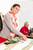 Smiling Female Dressmakers Stock Photos