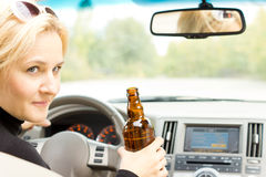 Smiling female driver drinking and talking Stock Images