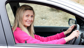 Smiling female driver at the wheel Royalty Free Stock Photo