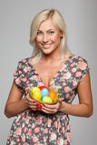 Smiling female with Easter eggs Royalty Free Stock Photo