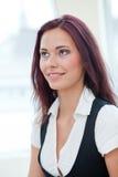 Smiling female employee Stock Images