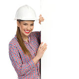 Smiling Female Engineer With Banner Stock Photo