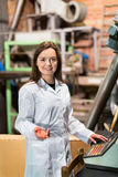 Smiling female engineer with   olive devices Stock Photo