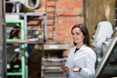 Smiling female engineer with   olive devices Royalty Free Stock Images
