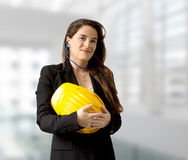 Smiling female engineer with safety helmet and earplugs, Stock Photos