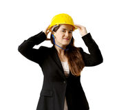 Smiling female engineer with safety helmet and earplugs over whi Royalty Free Stock Photo