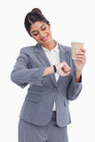 Smiling female entrepreneur with paper cup Stock Images