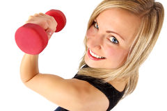 Smiling female excercising. Young well shaped blonde excercising with weights Royalty Free Stock Photo