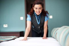 Smiling female executive giving final touches Stock Images