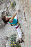 Smiling female extreme climber Royalty Free Stock Photo