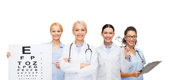 Smiling female eye doctors and nurses Stock Photos